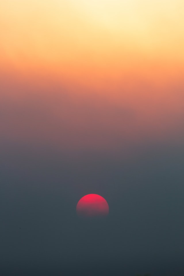 smoke turns sun red